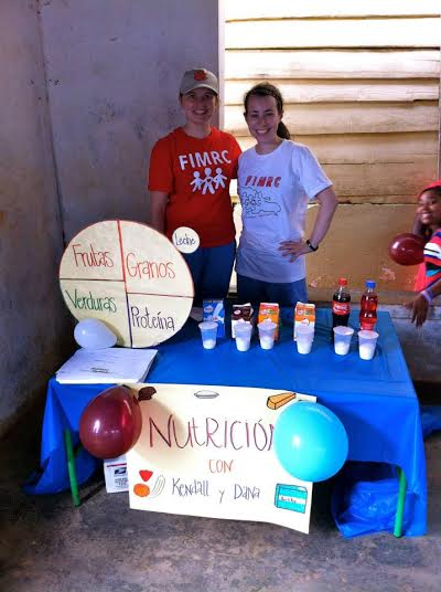 Kendall and Dana stationed at their nutrition booth for the health fair in El Carrizal.